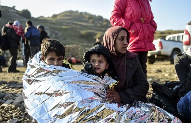 ct-france-refugees-huppke-20151118.jpg